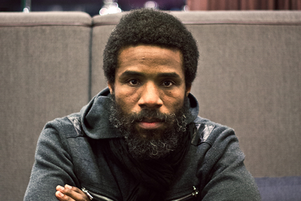 Cody ChesnuTT posing for a picture and looking hot af with a wool jacket on.jpg