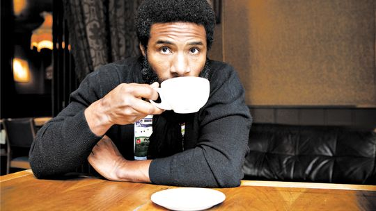 Cody ChesnuTT in a café sipping coffee and looking gorgeous af.jpg
