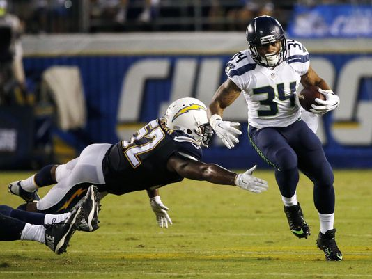 Thomas Rawls looking gorgeous in a white jersey as he beats the San Diego Chargers.jpg