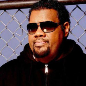 Fatman Scoop looking hot behind a chainlink fence.jpg