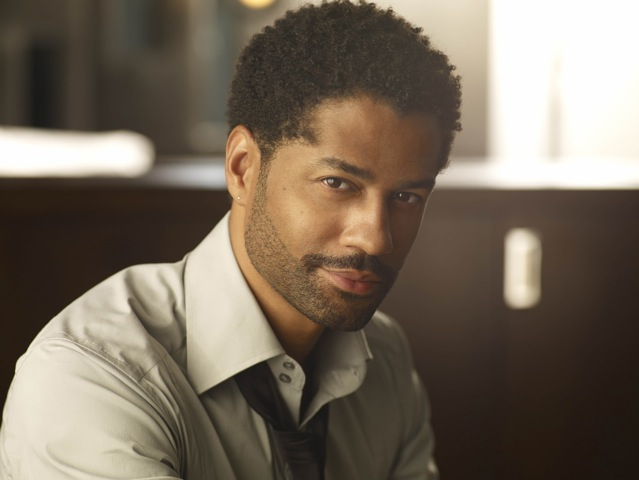 Eric Benét looking hot af in a dark linen dress shirt with the collar loosely opened.jpg