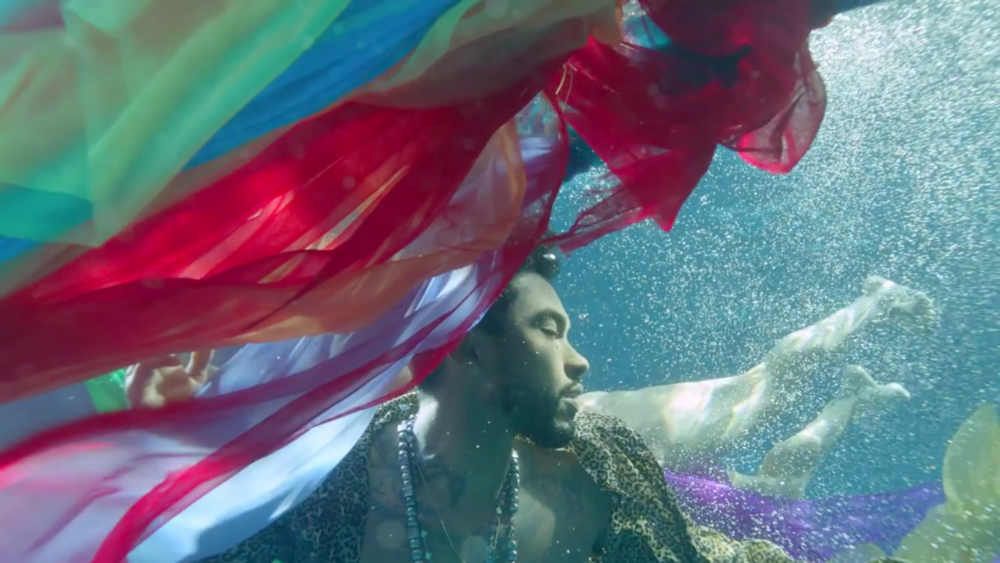 Miguel submerged in a body of water looking hot af in the Waves video teaser.jpg
