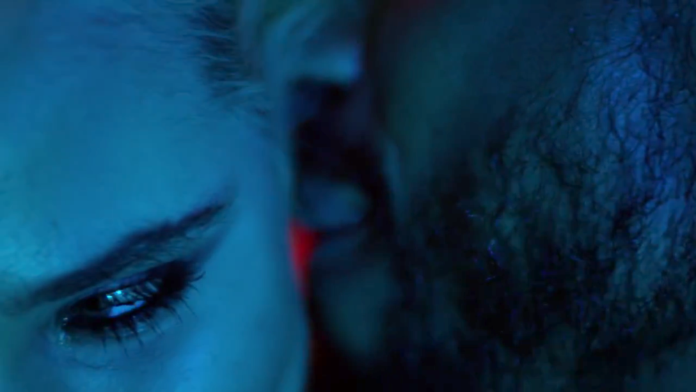 Miguel looking hot whispering in a girl's ear in the Waves video teaser.jpg