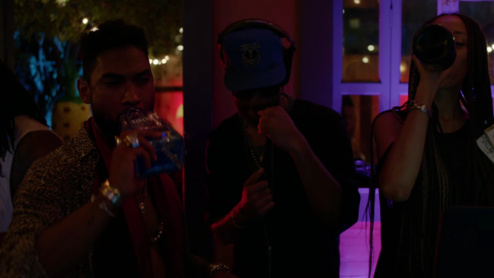 Miguel drinking 1800 Tequila from the bottle in the Waves video.jpg
