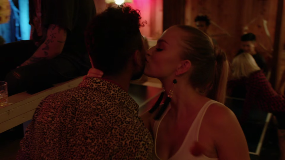 some girl giving Miguel a kiss on the cheek in the Waves video.jpg