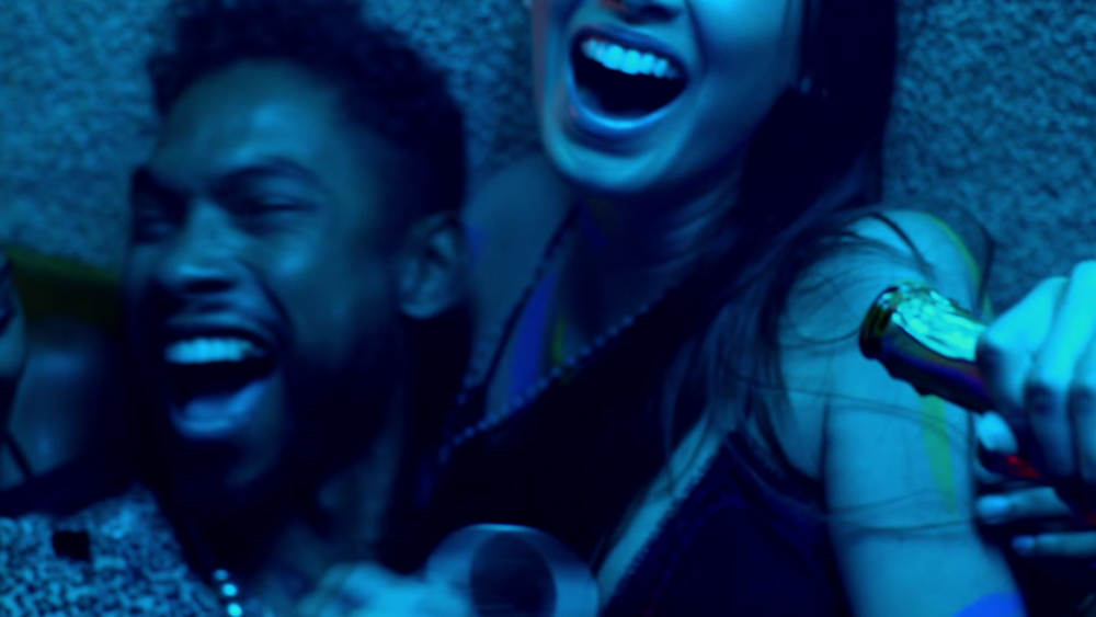 Miguel having a good time at the party in the Waves video omg look how hot he is.jpg