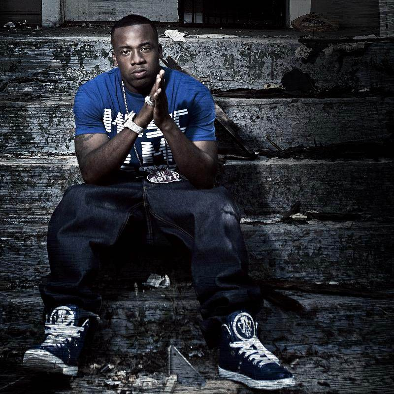 Yo Gotti looking hot on a staircase in blue.jpg