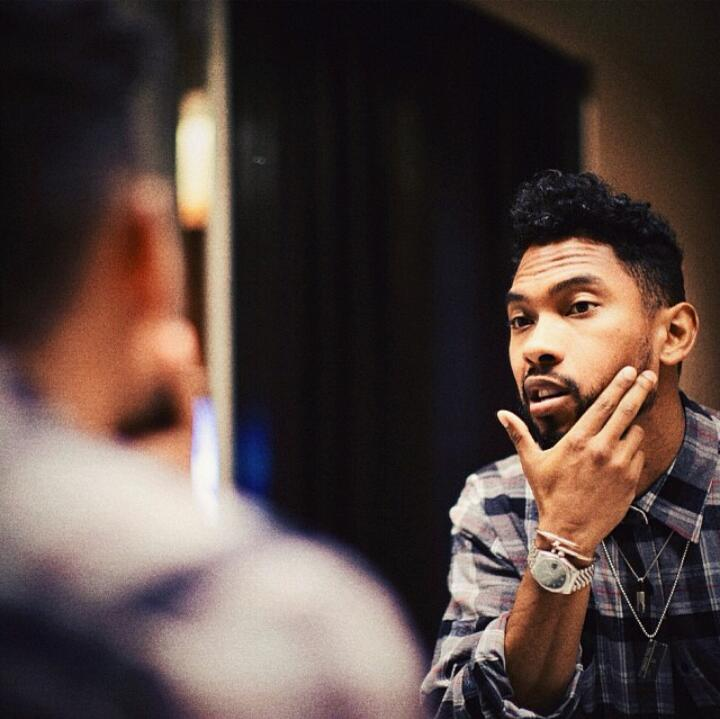 Miguel looking at himself in the mirror looking perfect as he usually does because he is perfect and hot.jpg