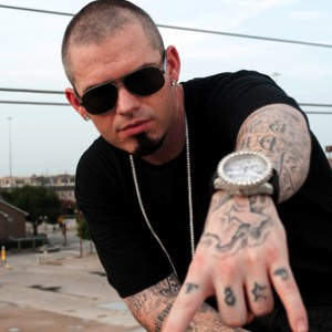 Paul Wall looking hot in a black t-shirt outside.jpg