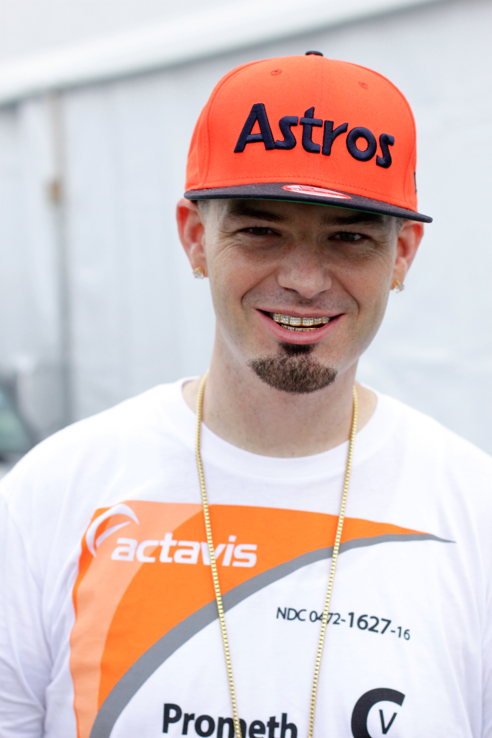 Paul Wall looking hot in an orange Houston Astros hat.jpg