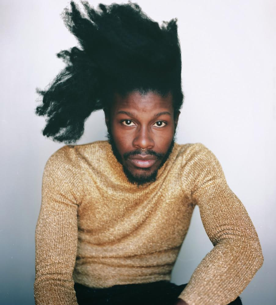 Jesse Boykins III looking gorgeous in a beige top.jpg