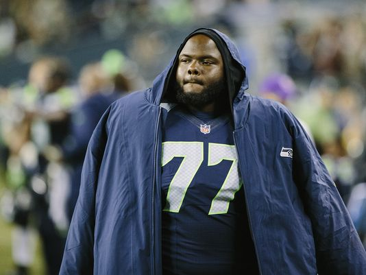 Ahtyba Rubin looking hot on the sidelines while wearing a Seahawks jacket.jpg