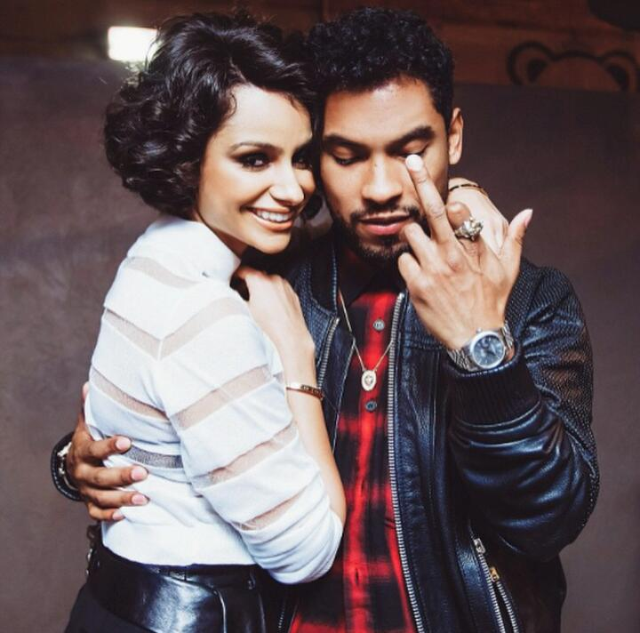 Miguel and Nazanin Mandi looking perfect in a picture while Miguel gives the photographer the finger.jpg