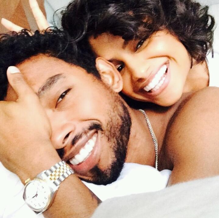 Miguel and his girlfriend Nazanin Mandi in bed smiling with true genuine smiles looking so happy.jpg