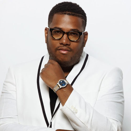 Guordan Banks looking hot in a white suit.jpg