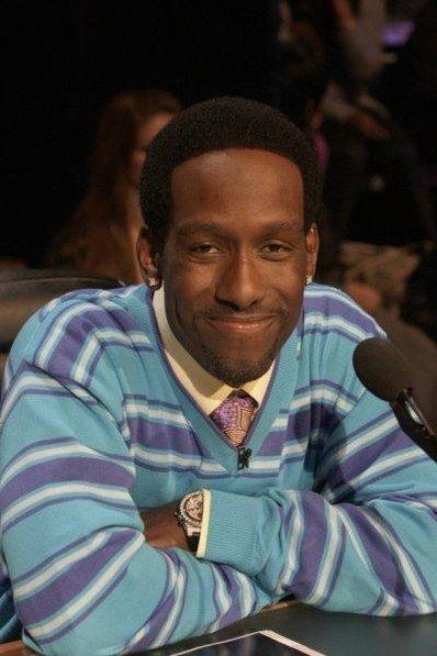 Shawn Stockman looking hot in a blue and purple and white striped sweater.jpg