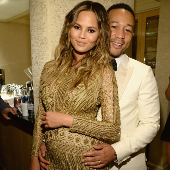 Chrissy Teigen and John Legend in a picture before their spawn is birthed.jpg