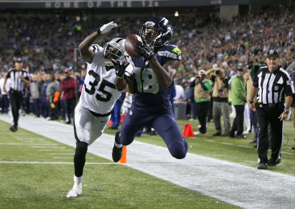 Kasen Williams looking hot as he intercepts the ball against the sorry Raiders.jpg