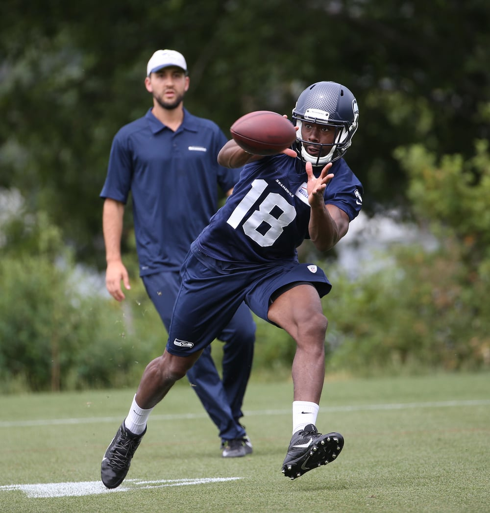 Kasen Williams looking hot on the field at practice as he catches the ball.jpg