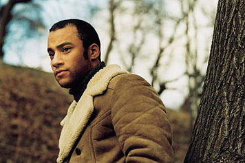 Stephen Simmonds looking hot while wearing a beige sherpa-lined coat.jpg