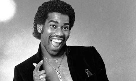 Kurtis Blow looking hot with no shirt on underneath his blazer.jpg