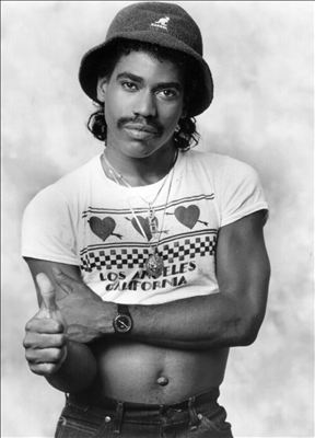 Kurtis Blow wearing a belly shirt looking really hot idc he's gorgeous.jpg