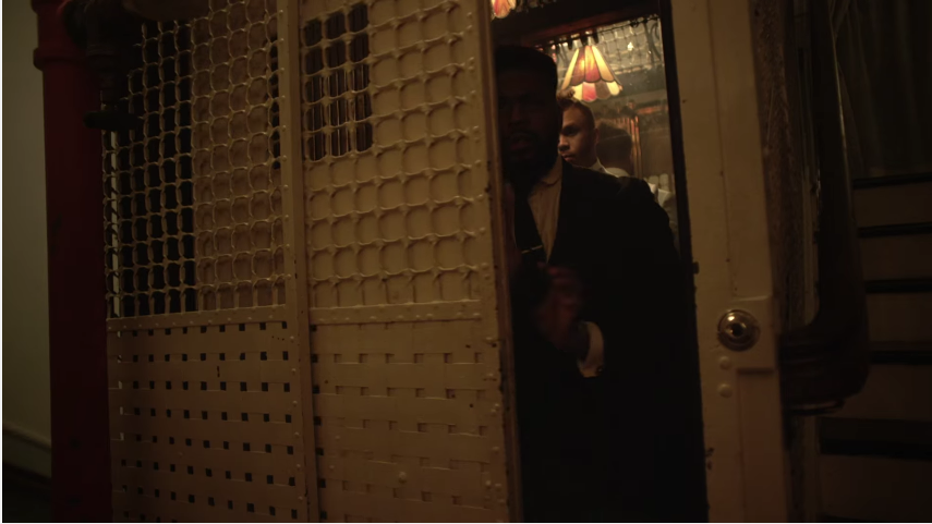 Jidenna and a small handful of his illuminati recruits escaping to the elevator in the Knickers video.jpg