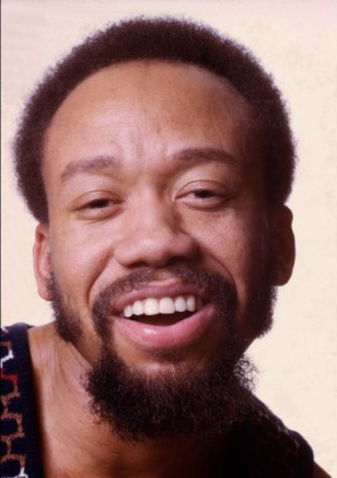 Maurice White and his gorgeous smile in the 80s.jpg