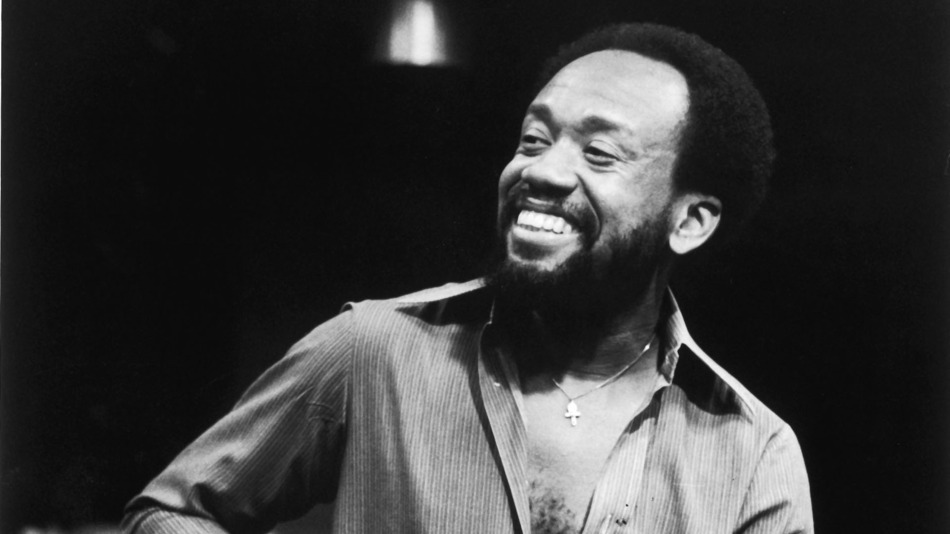 Maurice White and his really hot smile in a greyscale picture.jpg