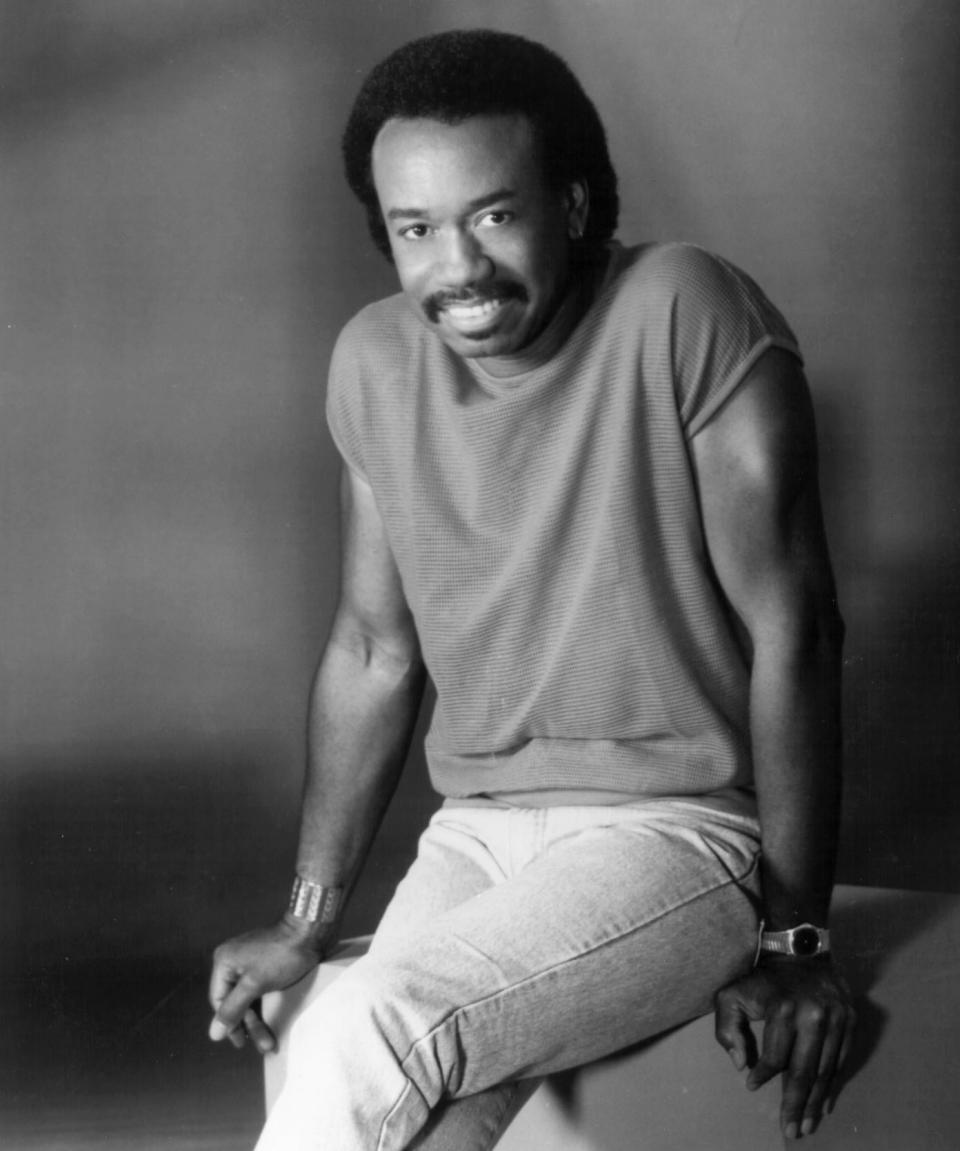 Maurice White looking hot in a studio photo pose on a chair.jpg