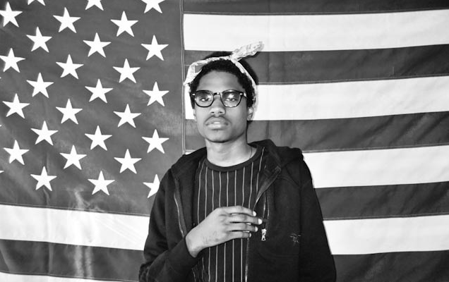 A$AP Dom behind an American Flag looking hot.jpg