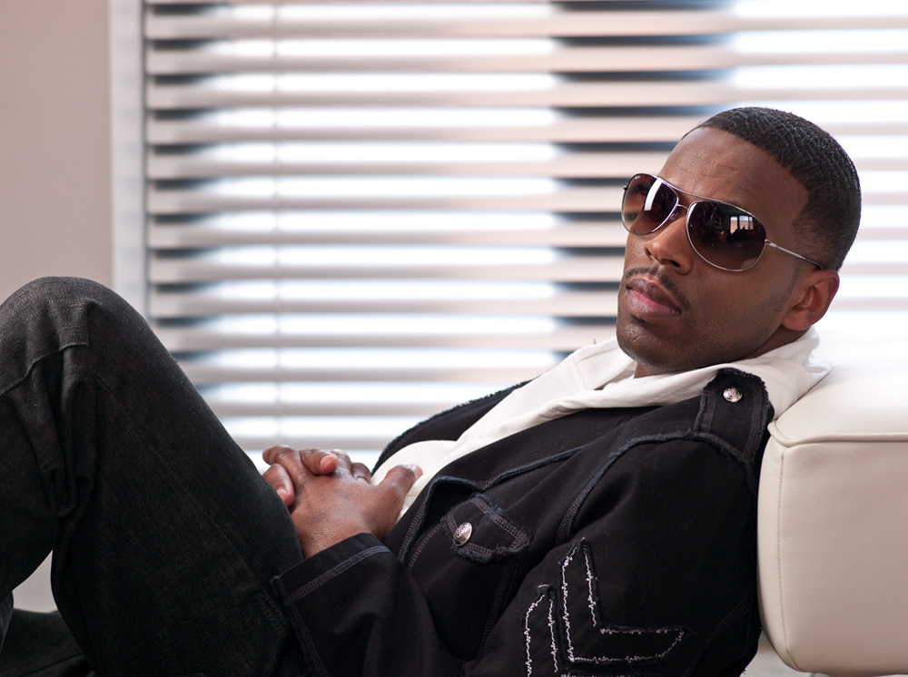 K'Jon looking hot sitting down on a white leather sofa.jpg
