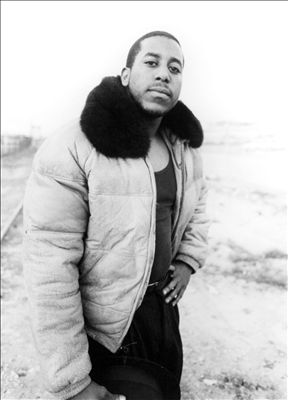 Tone Loc looking good in a wife beater and a jacket with a fur neck.jpg