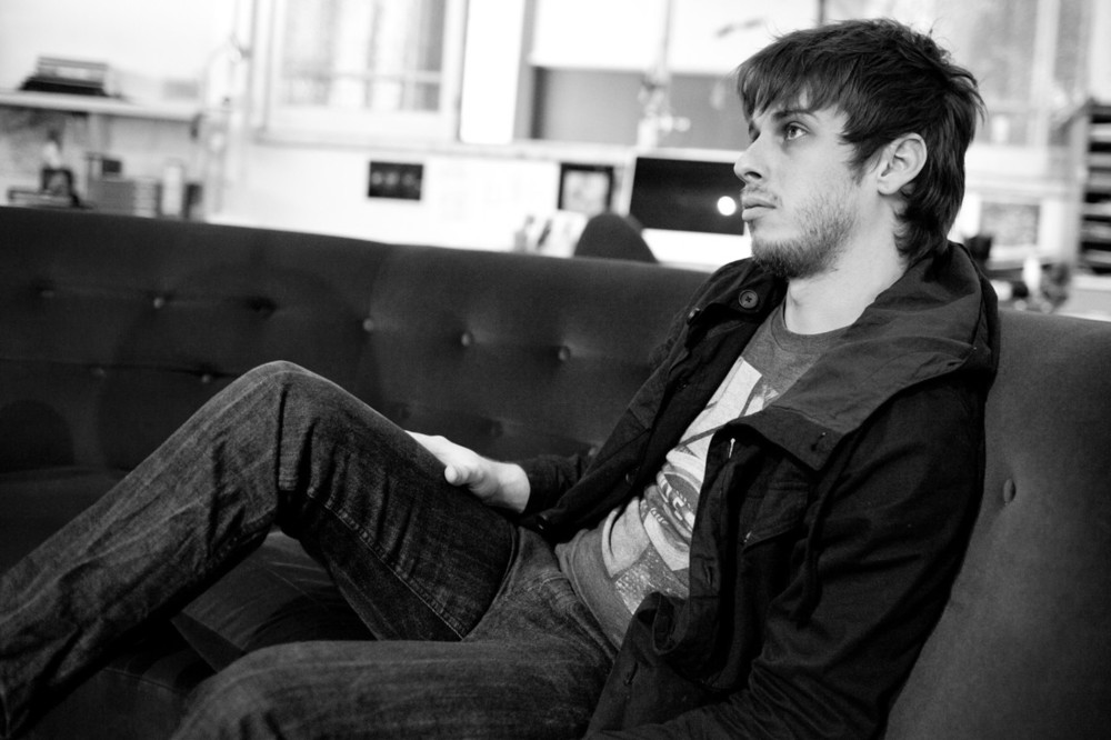 Mark Foster looking hot af on a couch in a greyscale picture.jpg