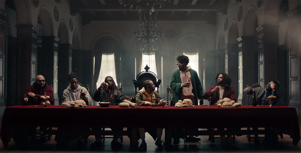 Kendrick Lamar's last supper inside the church w only rolls and wine.jpg