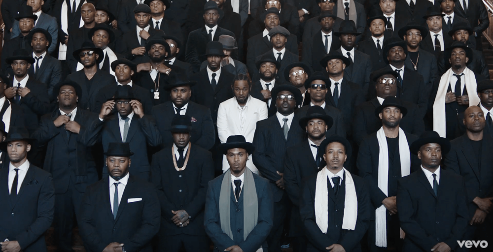 Kendrick Lamar and his giant suit gang in the Humble video on the steps of the church or whatever.jpg