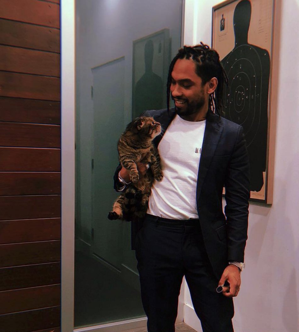 Miguel looking gorgeous whilst holding his cat Munch in his home.jpg
