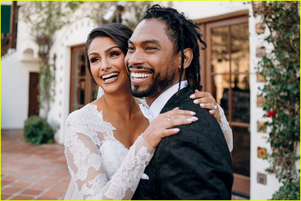 Miguel and Nazanin happily smiling at their wedding.jpg