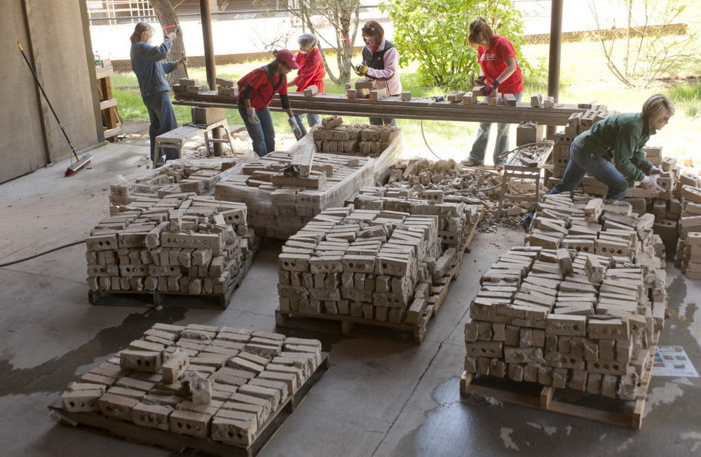 Before The Edwards Center builds its new community center in Aloha, it is destroying an old building there. Volunteers recycled parts of the old building, including 9,000 bricks that would have cost $1.79 each to replace.
