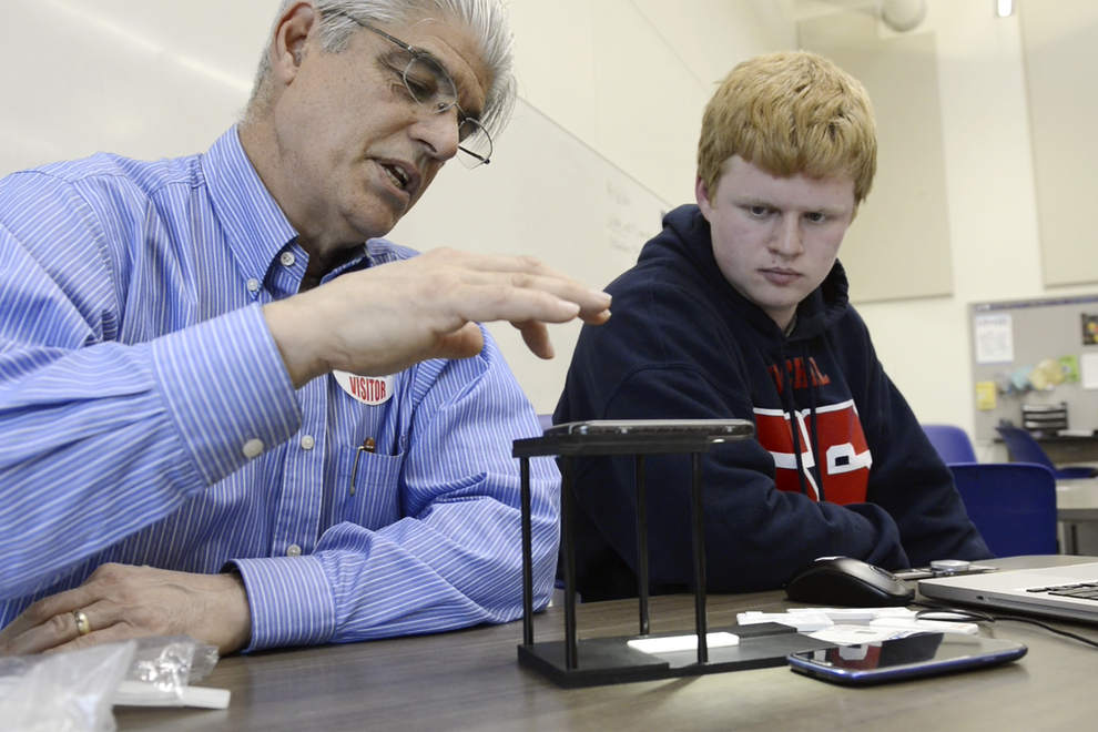 Immunologist Dr. Haynes Sheppard has teamed up with Churchill High School junior Caden Johnston to design and fabricate a prototype cellphone stand that will allow blood samples to be digitally photographed and sent for analysis. (Andy Nelson/The Register-Guard)