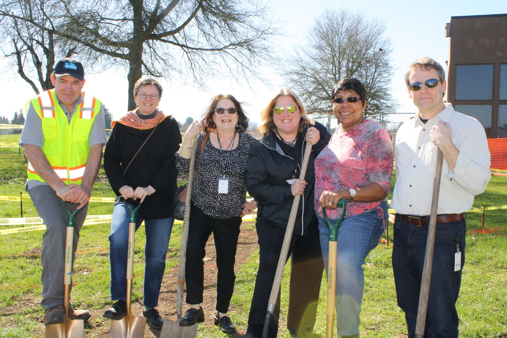 Members from the Clear Lake Head Start Playground design team celebrates groundbreaking.