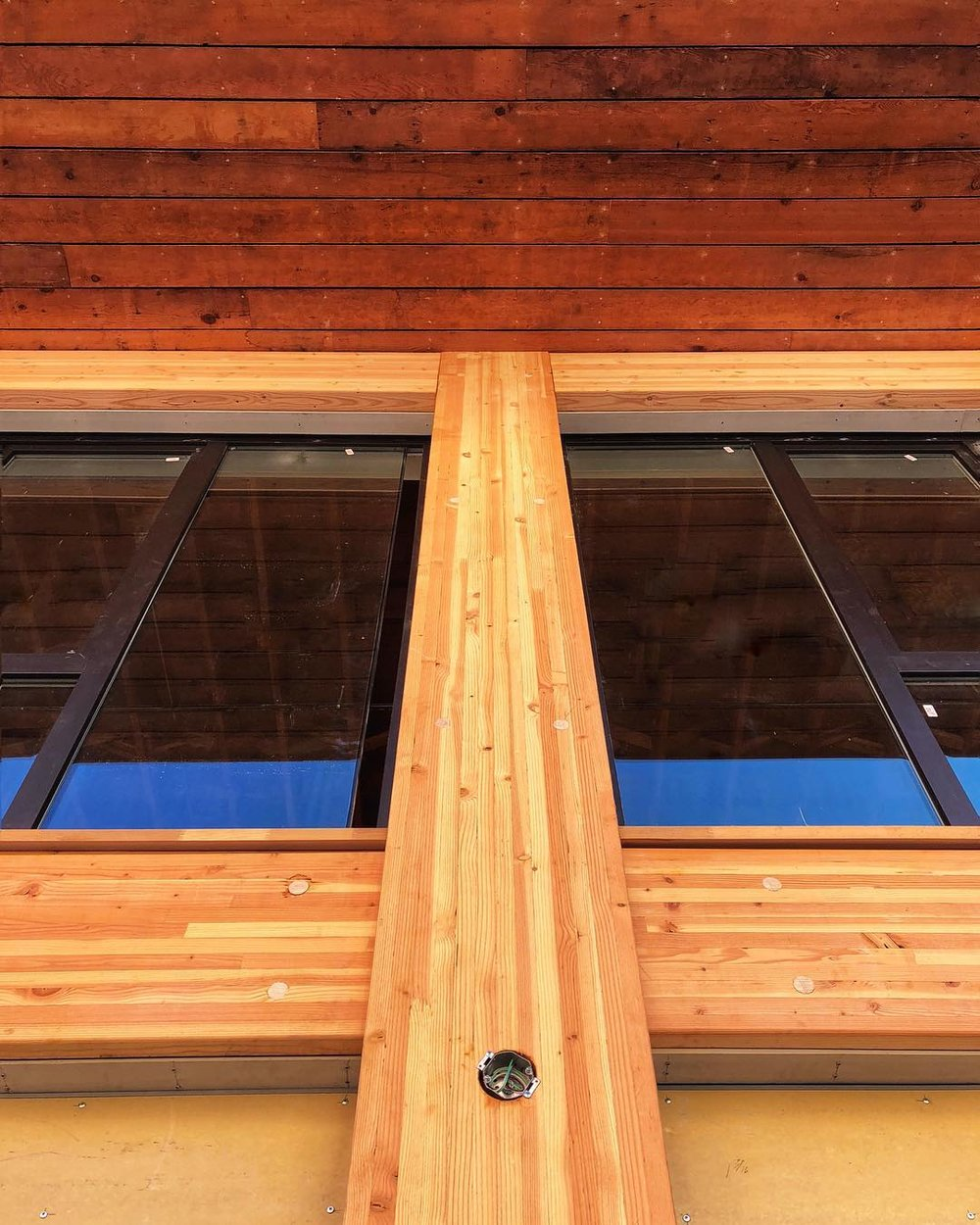 Wood Façade – New Glulams at Façade, Reclaimed Wood at Soffit