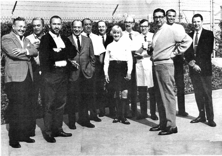 X seen here with the original Imagineering crew, (3rd from right with coffee.)