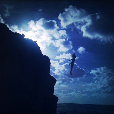 Cliff jumping at Waimea Beach, North Shore, Oahu, HI; Summer 2011