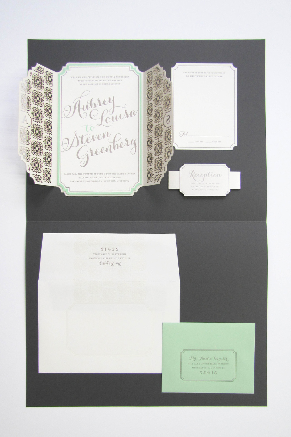 The Aubrey suite features a gorgeous laser cut with monogram detail and a die cute invite panel, reply card and belly band.