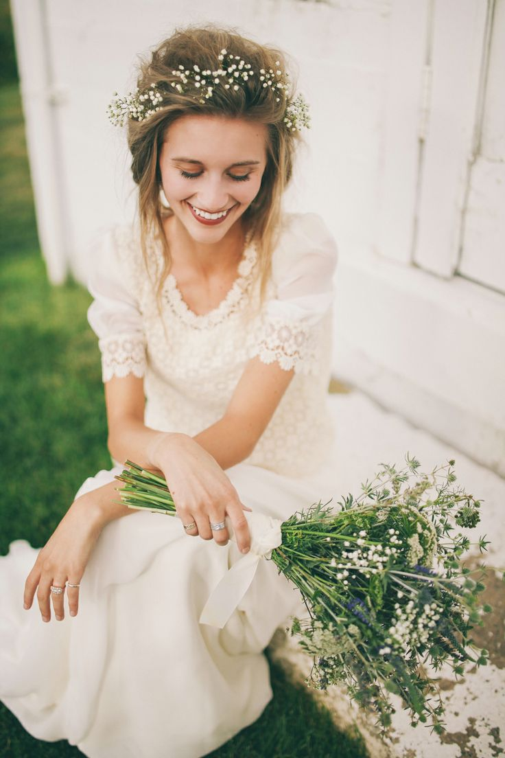 Love these simple floral elements and understated wedding gown. Credit: Jessica Janae Photography.