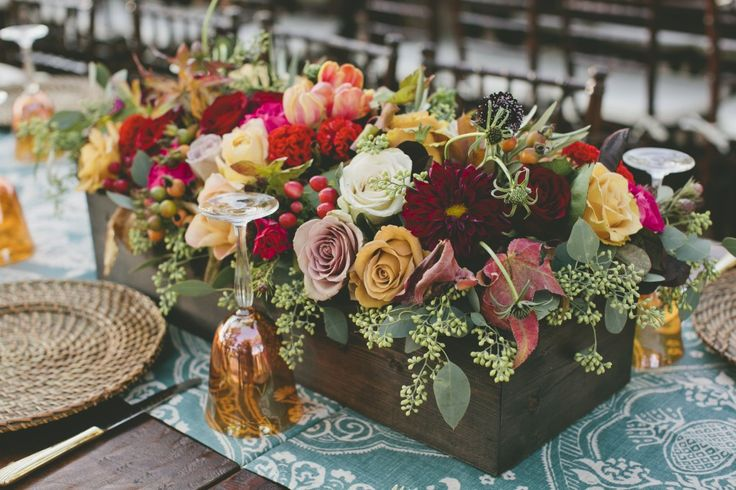 These gorgeous fall colored centerpieces just about knocked our socks off. Credit: Brock+ Co. Events.