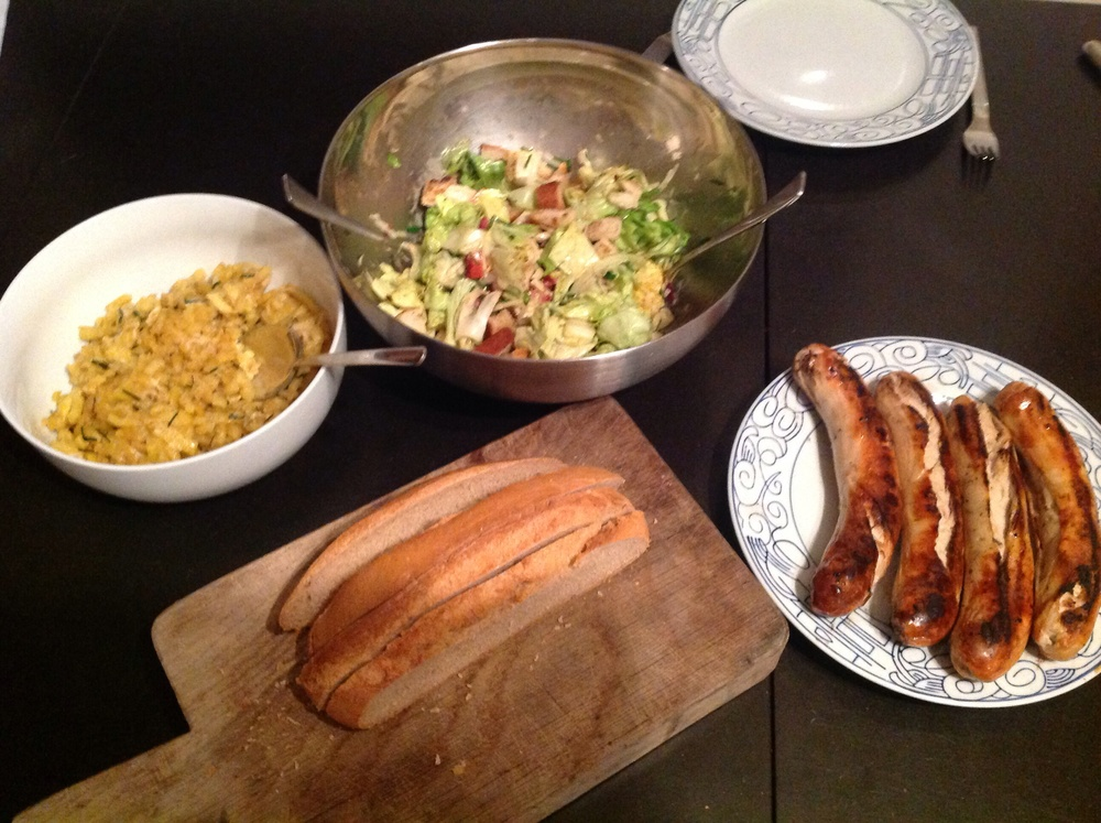 Spatzle, salad with bacon bits and Bratwurst ... Thinking cold Alps and warm hearths.
