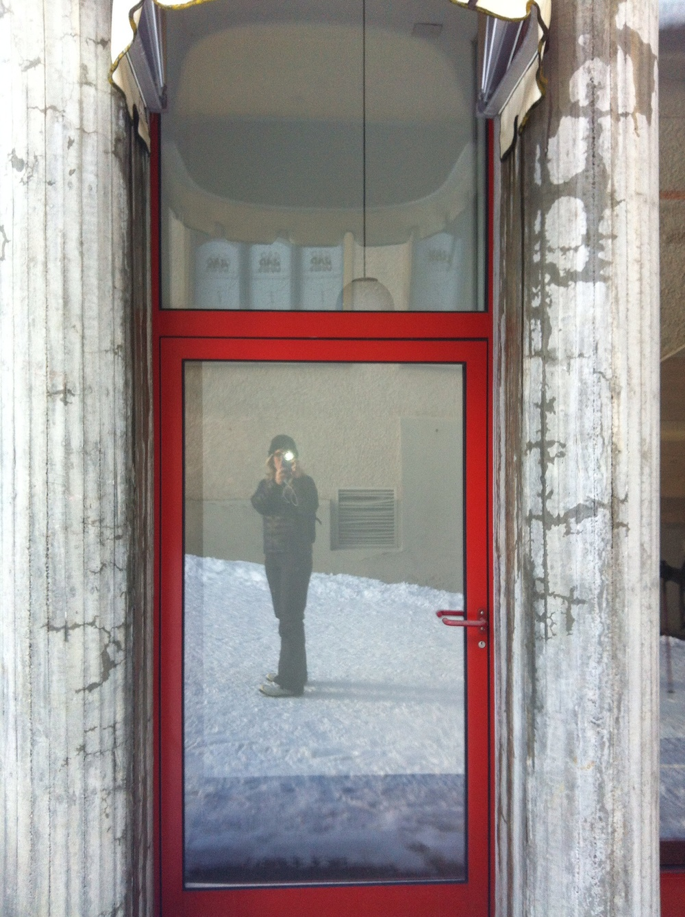 Me, reflected in the entrance to the abandoned hotel' snow defunct disco.