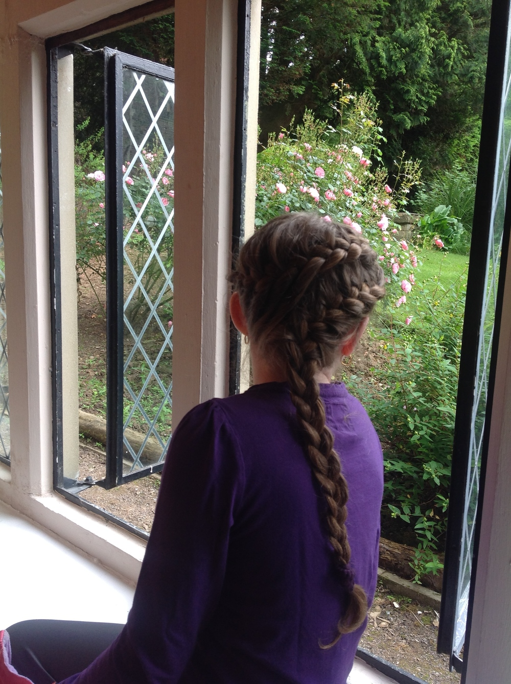 Kiddo, admiring the window seat view of the gardens and the feel of amazingly fresh air in Wales.